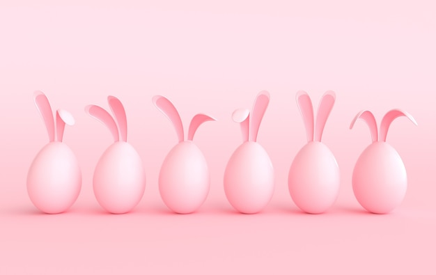 Collorful easter egg with rabbit ears on pastel pink background