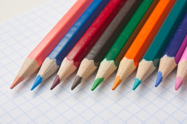 Colod pencils at school notebook