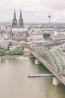 Cologne cathedral and famous bridge, aerial view