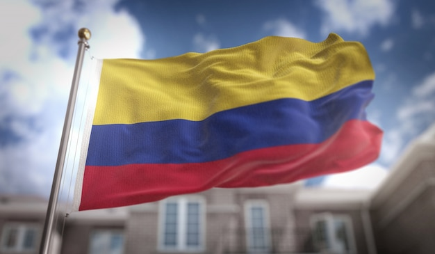 Colombia flag 3d rendering on blue sky building background