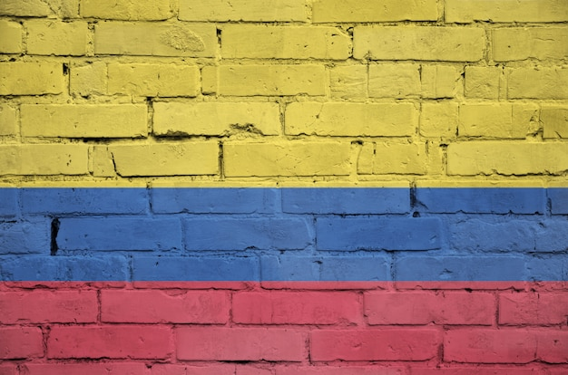 Colombia flag is painted onto an old brick wall
