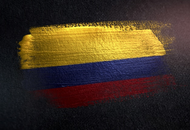 Colombia flag made of metallic brush paint on grunge dark wall