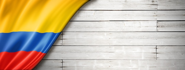 Colombia flag on old white wall. horizontal panoramic banner.