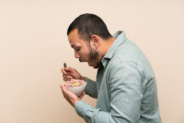 Colombian man holding a bowl of cereals