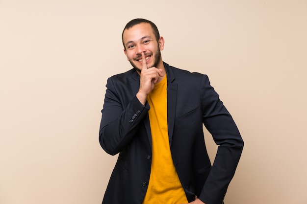 Colombian man over isolated background doing silence gesture