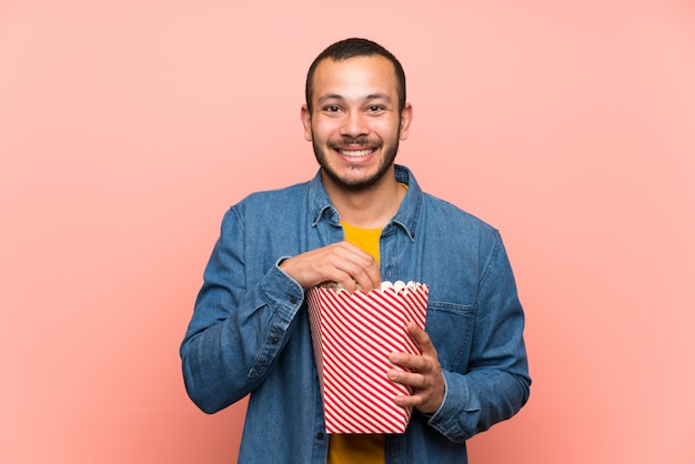Colombian man with popcornsover isolated pink