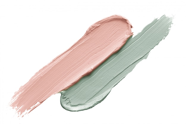 Color correcting concealer strokes isolated on white