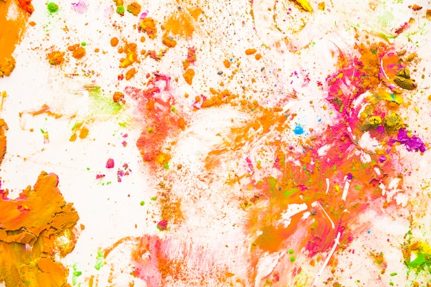 Color dust particles splattered on white background