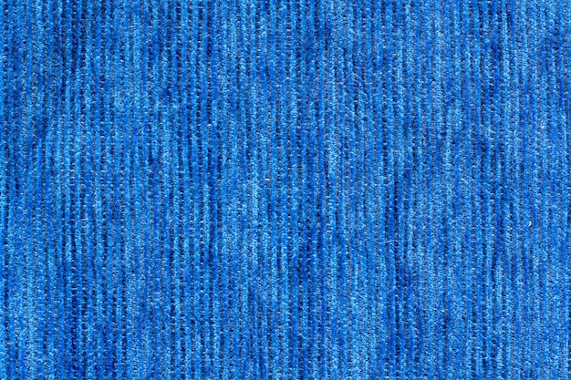 Текстура ткани цвета. мягкая синяя ткань с вертикальными линиями. копировать пространство