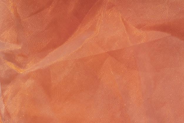 Текстура ткани цвета. тонкий мягкий мятый тюль коричневого цвета. скопируйте пространство.