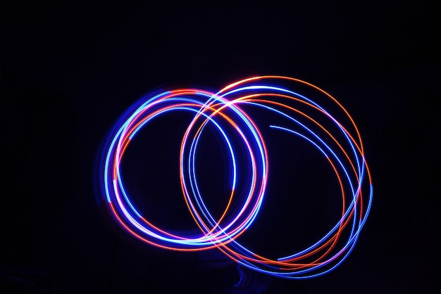 Color light lamp move cycle on long exposure shot in the dark.
