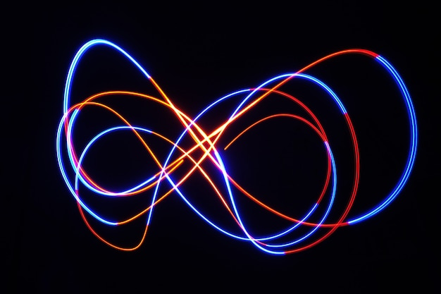 Color light lamp move round on long exposure shot in the dark.