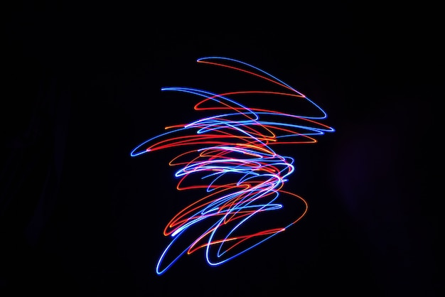 Color light lamp move twist on long exposure shot in the dark.