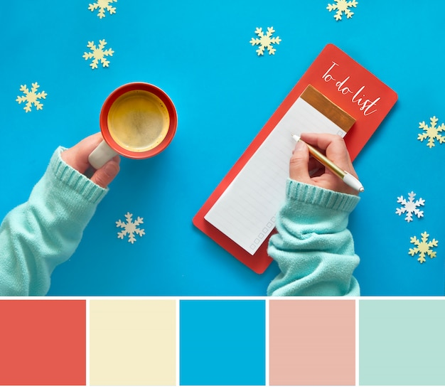 Color matching palette from woman's hands with to do list and coffee