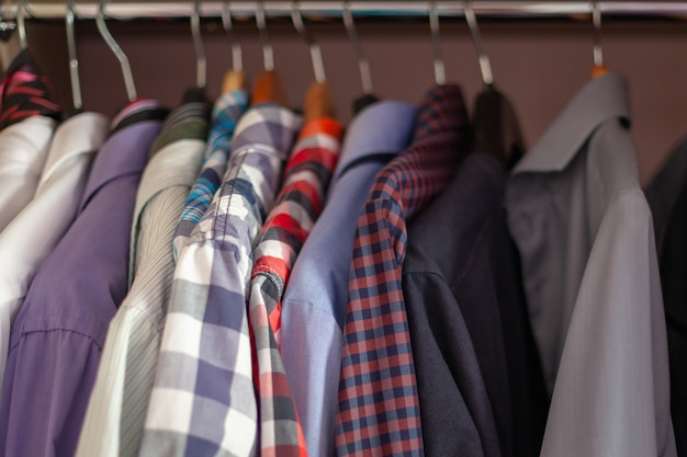Color mens shirts in satin leveled on rowing