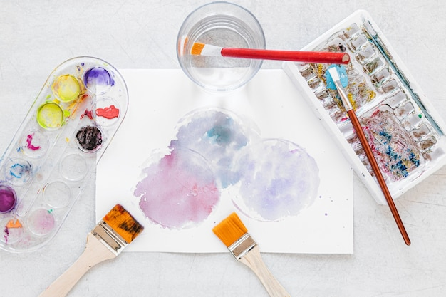 Color palette in box and paint splashes