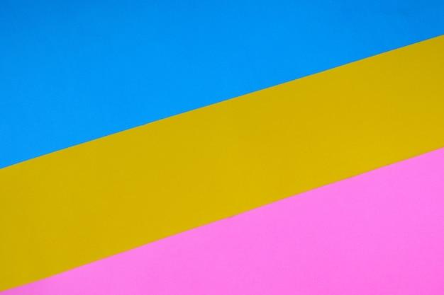 カラー紙の幾何学的な平らな背景