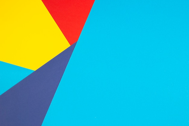 Color papers geometry flat composition wall with yellow, red and blue tones