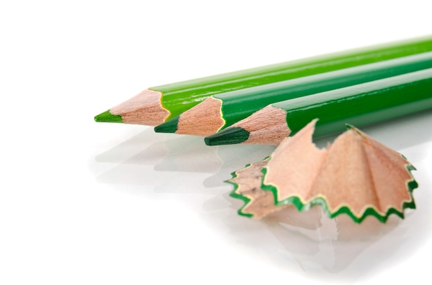 Color pencills with sharpening shavings on white background