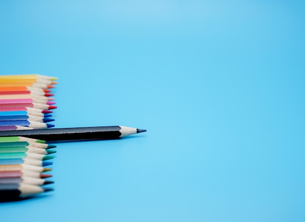 Color pencils on blue background   characteristics of leadership