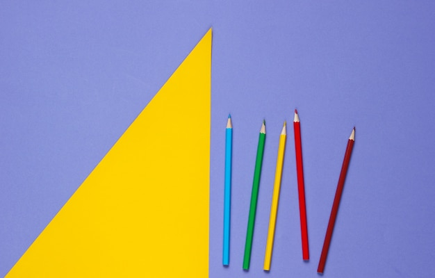 Color pencils on a purple yellow