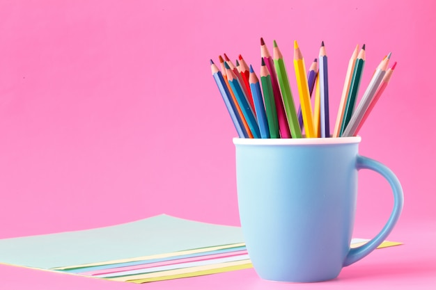 Color pens on a cup with papers