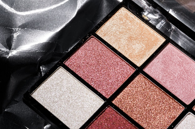 Color professional cosmetic palette on a dark background, close up