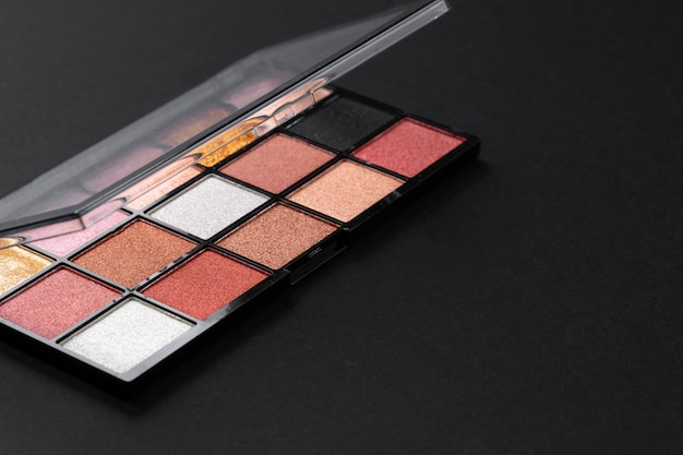 Color professional cosmetic palette on a dark background