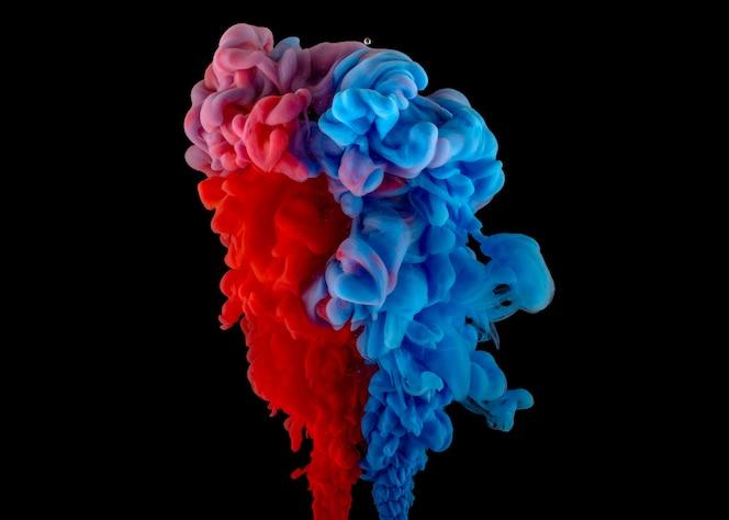 Color splashes of ink on black background