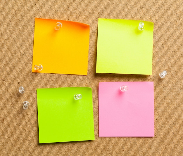 Color sticker notes over cork board background