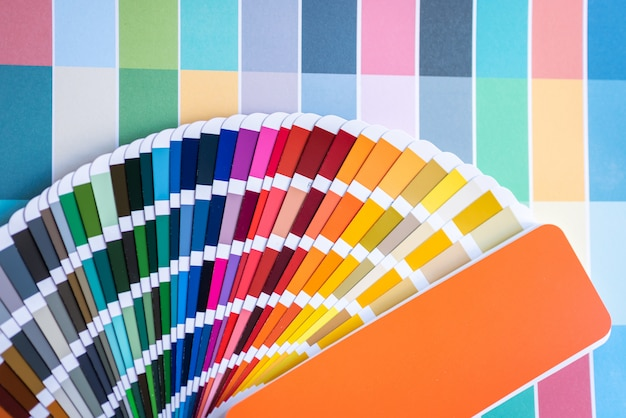 Color swatches of graphic designers putting on desk table.