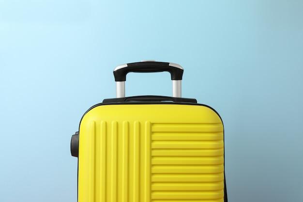 Color travel bag on blue, close up