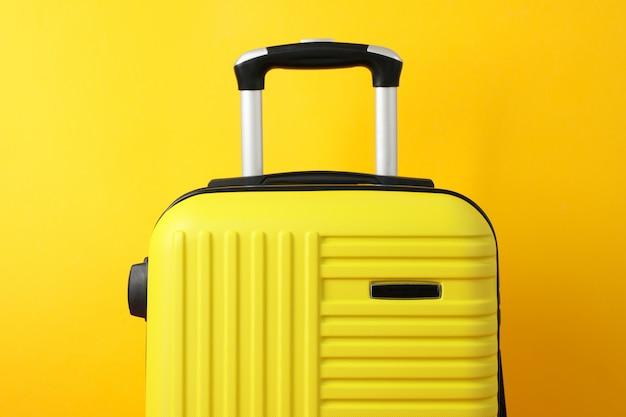 Color travel bag on yellow