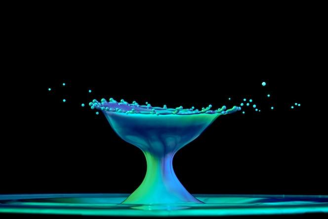 Color water drop explosion mushroom on a back backgroung liquid art
