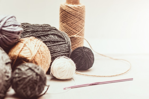Color woolen clews for knitting on white background