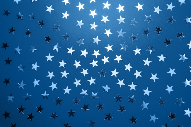 Color of the year 2020 classic blue pantone. silver star sprinkles . festive holiday confetti. celebration concept