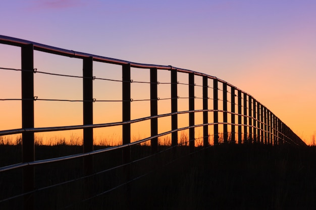 Colorado ranch fence at sunset