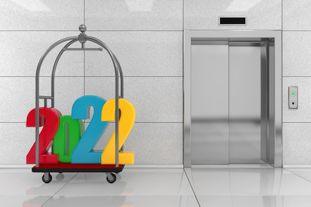 Colored 2022 new year sign over silver chrome luxury hotel luggage trolley cart in front of modern elevator or lift with metal doors in hotel building extreme closeup. 3d rendering