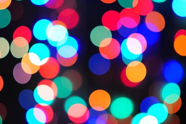 新年とクリスマスのためのボケ味の色の抽象的な背景