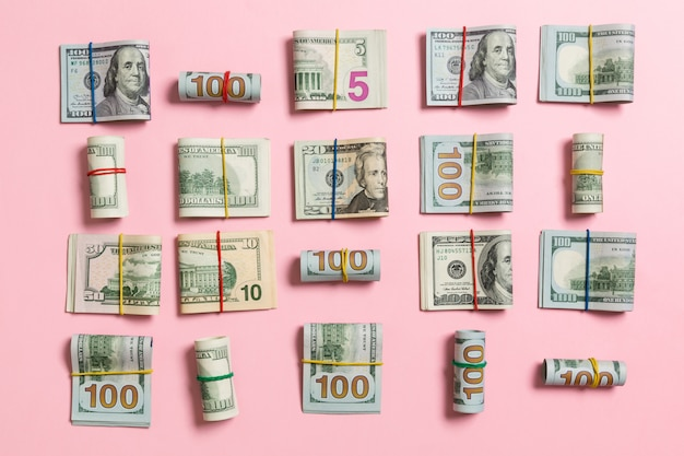 Colored background with money american hundred dollar bills on top wiev with copy space for your text in business concept