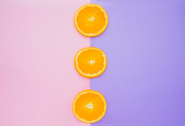 Colored background with orange slices
