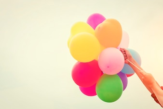 Colored balloons held by arms