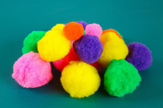 Colored beautiful pompons. assortment of pompons.