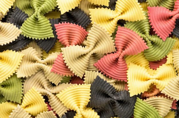 Colored bow tie pasta. closeup multiple farfalle.