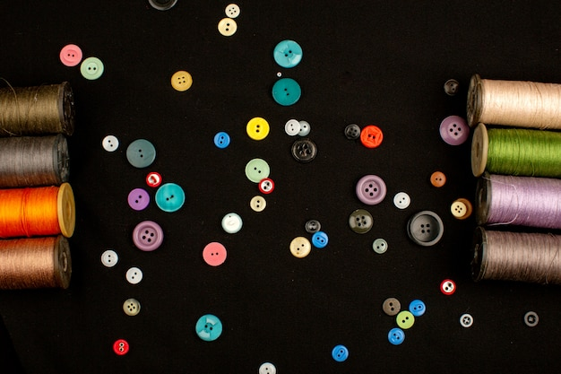 Colored buttons vintage along with multicolored sewing threads