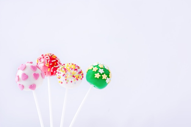 Colored cake pops on isolated white background