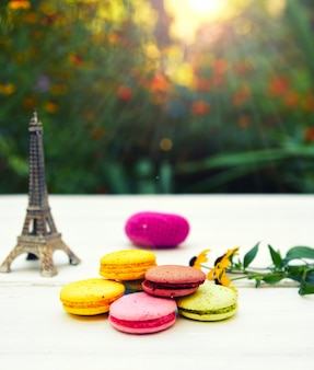Colored cakes macarons on a white table
