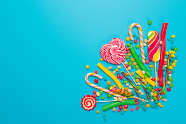 Colored candies on blue