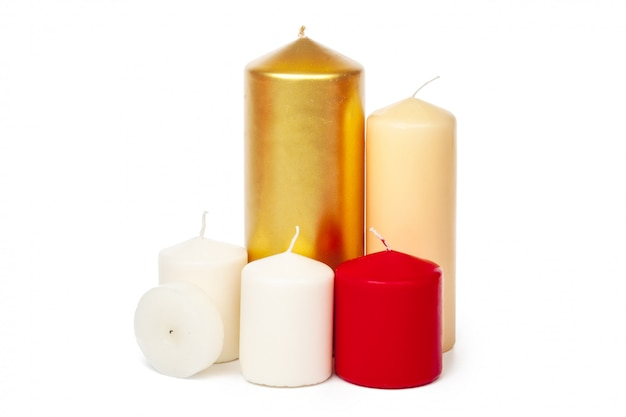 Colored candles of different size on white background