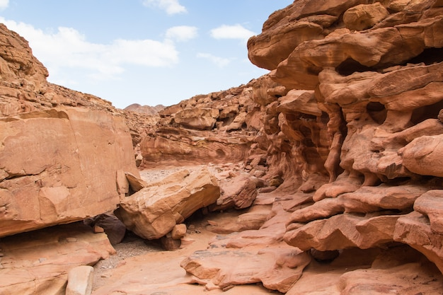 Colored canyon with red rocks and blue sky